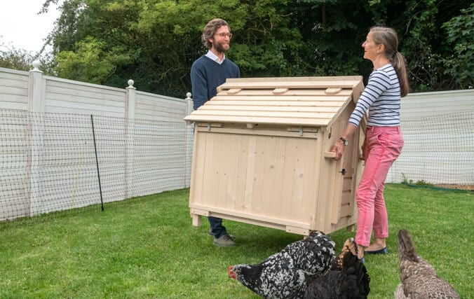moving a wooden chicken coop